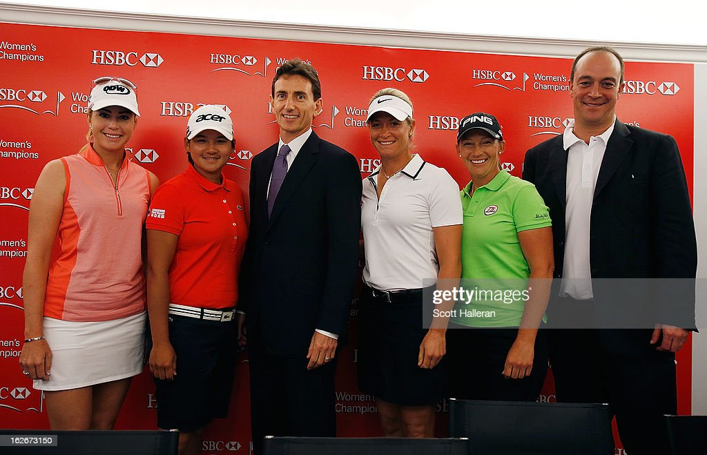 Alex Hungate, Group General Manager and CEO, HSBC Singapore (C) poses with LPGA players Paula Creamer, Yani Tseng, Suzann Pettersen and Giles Morgan, Global Head of Sponsorship + Events, HSBC (R) prior to the start of the HSBC Women's Champions at the Sentosa Golf Club on February 26, 2013 in Singapore, Singapore.