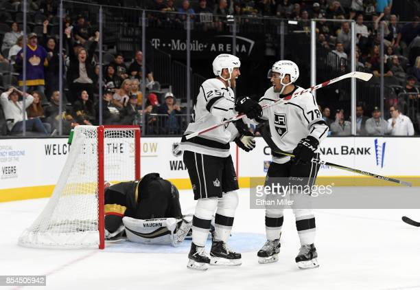 Alex Iafallo of the Los Angeles Kings celebrates with temmate Brooks Laich after he scored a gamewinning goal in overtime against Calvin Pickard of...