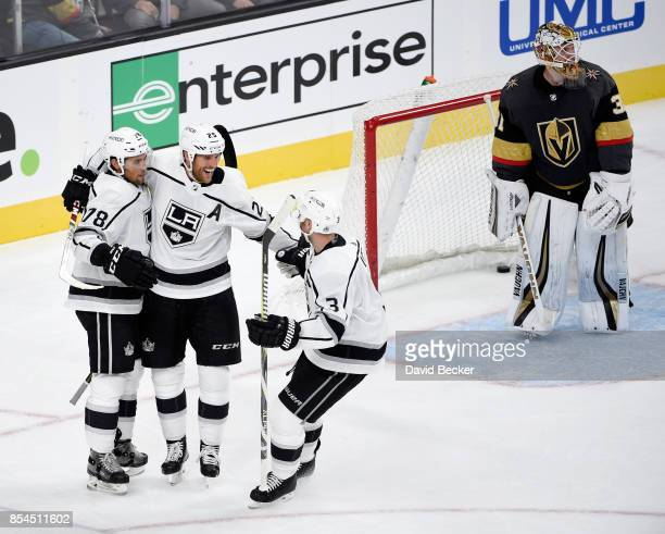 Alex Iafallo Brooks Laich and Chris Lee of the Los Angeles Kings celebrate the game winning goal after Laich scored during overtime against goalie...