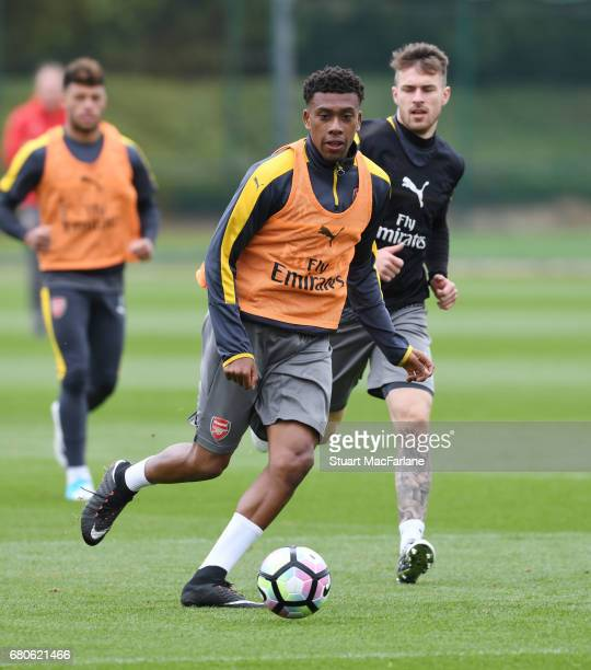Alex Iwobi and Aaron Ramsey of Arsenal during a training session at London Colney on May 9 2017 in St Albans England
