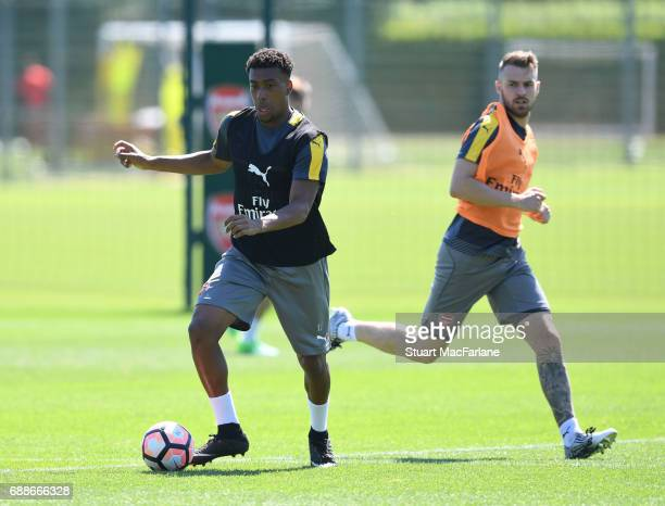 Alex Iwobi and Aaron Ramsey of Arsenal during a training session at London Colney on May 26 2017 in St Albans England