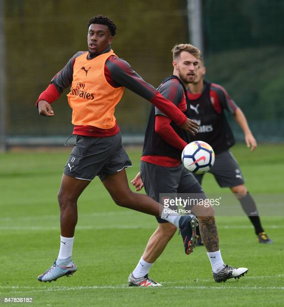 Alex Iwobi and Aaron Ramsey of Arsenal during Arsenal 1st team training session at London Colney on September 16 2017 in St Albans England