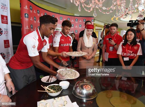 Alex Iwobi and Alex OxladeChamberlain of Arsenal takes part in a chinese cooking event for Emirates on July 21 2017 in Beijing China