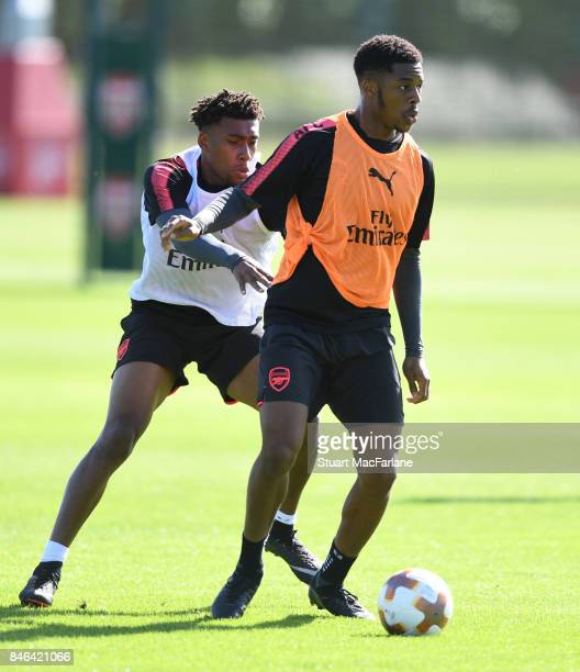 Alex Iwobi and Chuba Akpom of Arsenal during a training session at London Colney on September 13 2017 in St Albans England