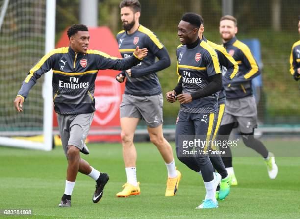Alex Iwobi and Danny Welbeck of Arsenal during a training session at London Colney on May 15 2017 in St Albans England