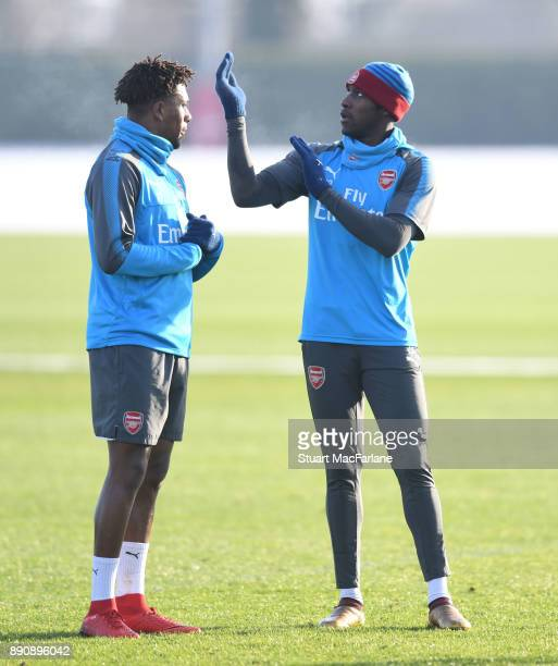 Alex Iwobi and Danny Welbeck of Arsenal during a training session at London Colney on December 12 2017 in St Albans England