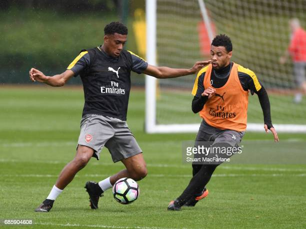 Alex Iwobi and Francis Coquelin of Arsenal during a training session at London Colney on May 20 2017 in St Albans England