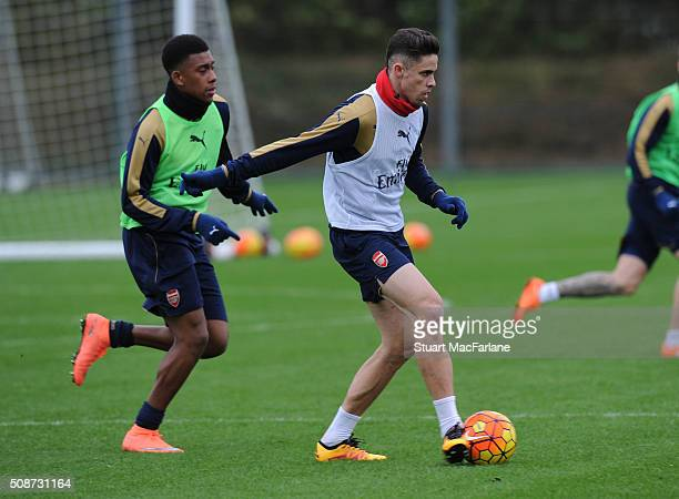 Alex Iwobi and Gabriel of Arsenal during a training session at London Colney on February 6 2016 in St Albans England