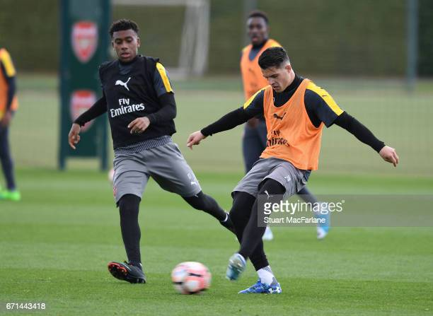 Alex Iwobi and Granit Xhaka of Arsenal during a training session at London Colney on April 22 2017 in St Albans England