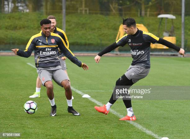 LR0 Alex Iwobi and Granit Xhaka of Arsenal during a training session at London Colney on May 6 2017 in St Albans England