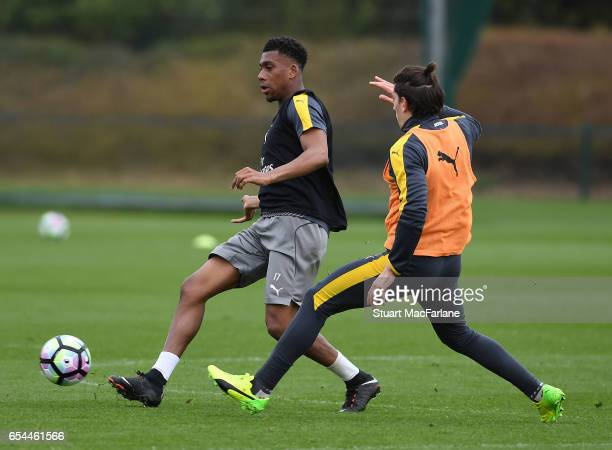 Alex Iwobi and Hector Bellerin of Arsenal during a training session at London Colney on March 17 2017 in St Albans England