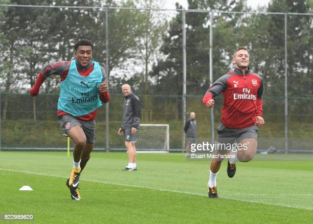 Alex Iwobi and Jack Wilshere of Arsenal during a training session at London Colney on July 26 2017 in St Albans England