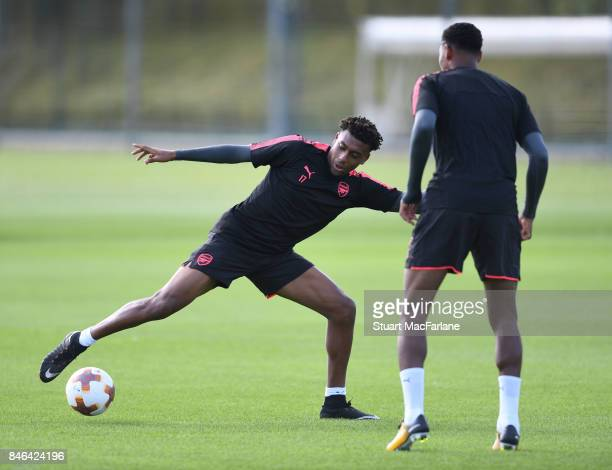 Alex Iwobi and Jeff ReineAdelaide of Arsenal during a training session at London Colney on September 13 2017 in St Albans England