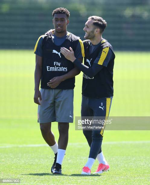 LR0 Alex Iwobi and Lucas Perez of Arsenal during a training session at London Colney on May 26 2017 in St Albans England