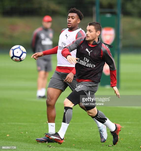 Alex Iwobi and Mathieu Debuchy of Arsenal during a training session at London Colney on October 13 2017 in St Albans England