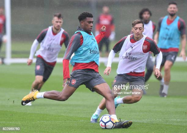 Alex Iwobi and Mesut Ozil of Arsenal during a training session at London Colney on July 26 2017 in St Albans England