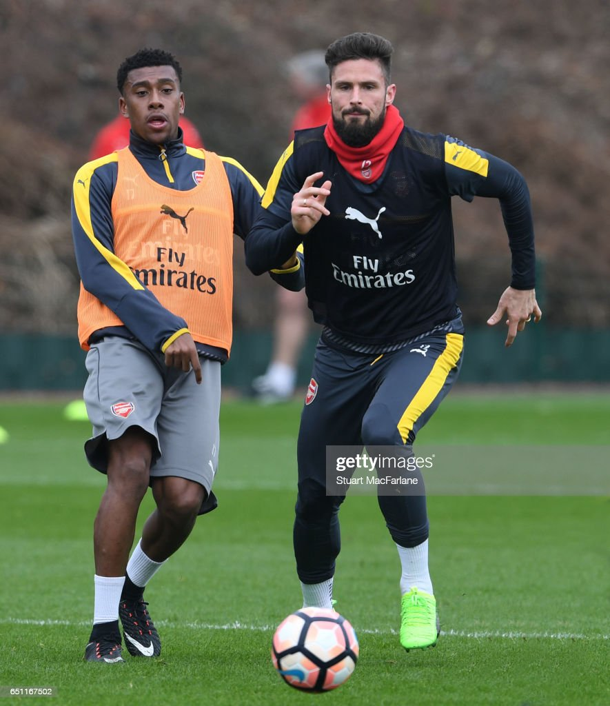 Alex Iwobi and Olivier Giroudof Arsenal during a training session at London Colney on March 10, 2017 in St Albans, England.