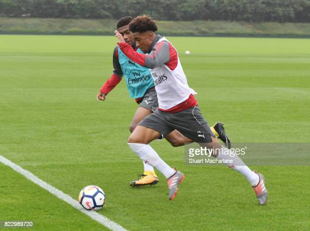 Alex Iwobi and Reiiss Nelson of Arsenal during a training session at London Colney on July 26 2017 in St Albans England