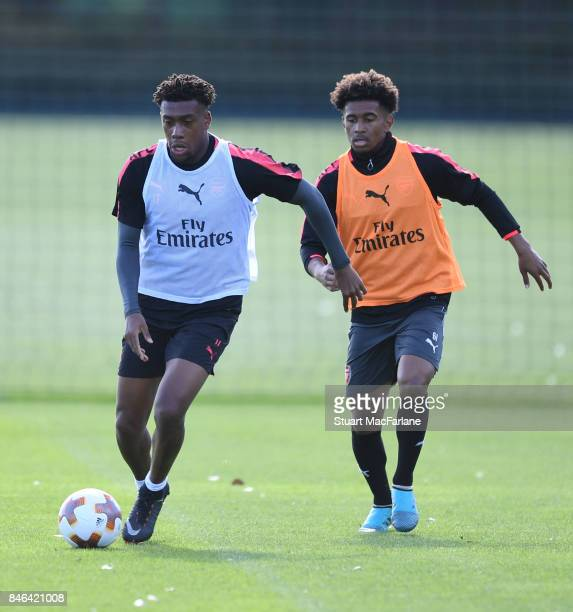 Alex Iwobi and Reiss Nelson of Arsenal during a training session at London Colney on September 13 2017 in St Albans England