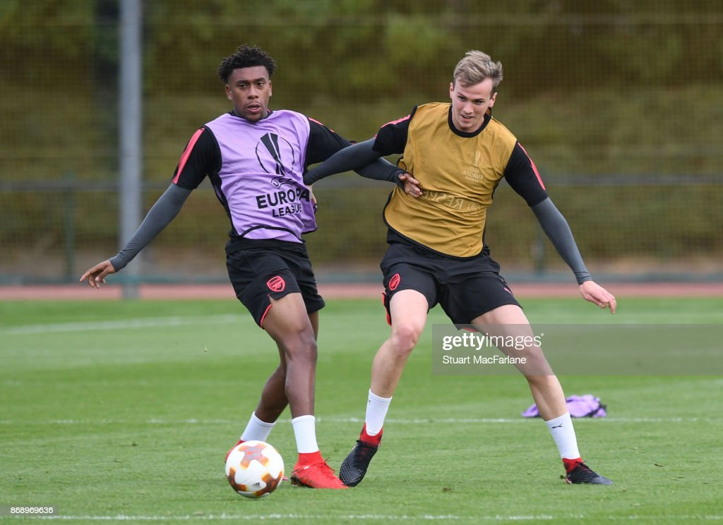 Alex Iwobi and Rob Holding of Arsenal during a training session at London Colney on November 1, 2017 in St Albans, England.