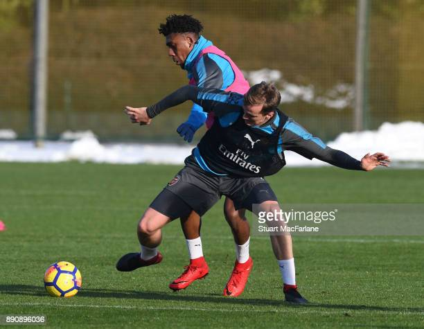 Alex Iwobi and Rob Holding of Arsenal during a training session at London Colney on December 12 2017 in St Albans England