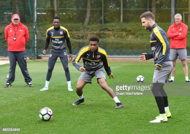 Alex Iwobi and Shkodran Mustafi of Arsenal during a training session at London Colney on May 15 2017 in St Albans England