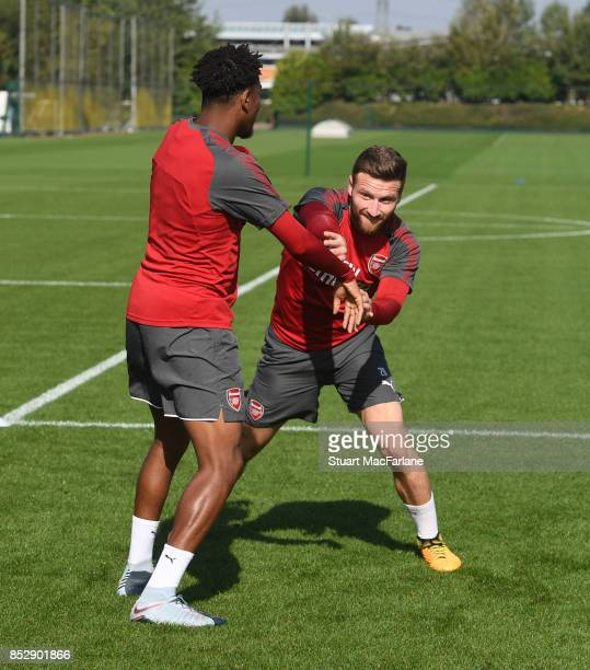 Alex Iwobi and Shkodran Mustafi of Arsenal during a training session at London Colney on September 24 2017 in St Albans England