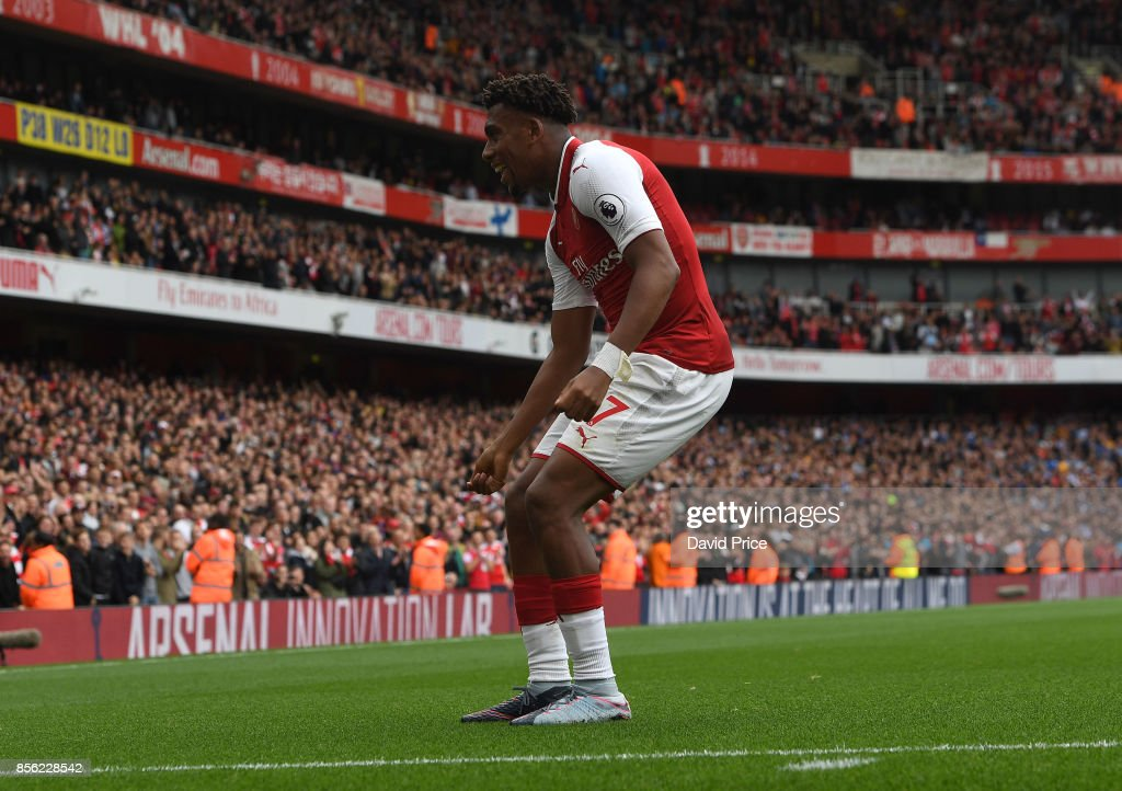 Alex Iwobi celebrates scoring Arsenal's 2second goal during the Premier League match between Arsenal and Brighton and Hove Albion at Emirates Stadium on October 1, 2017 in London, England.
