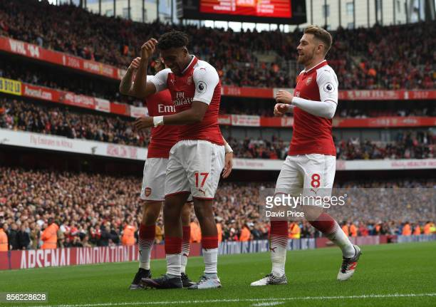 Alex Iwobi celebrates scoring Arsenal's second goal with Hector Bellerin and Aaron Ramsey during the Premier League match between Arsenal and...
