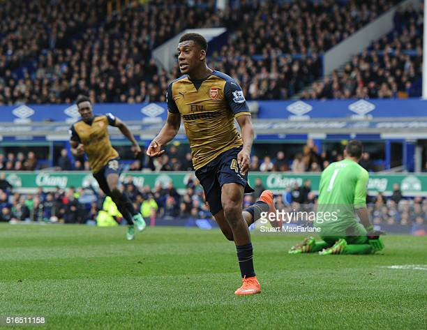 Alex Iwobi celebrates scoring the 2nd Arsenal goal during the Barclays Premier League match between Everton and Arsenal at Goodison Park on March 19...