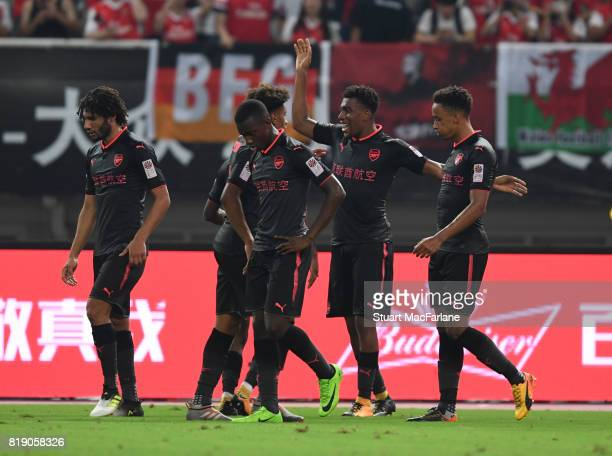 Alex Iwobi celebrates scoring the Arsenal goal with Cohen Bramall and Reiss Nelson during a pre season friendly between Bayern Munich and Arsenal at...
