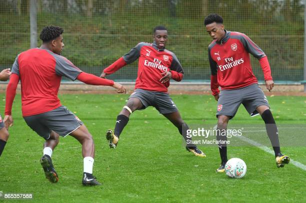 Alex Iwobi Eddie Nketiah and Joe Willock of Arsenal during a training session at London Colney on October 23 2017 in St Albans England