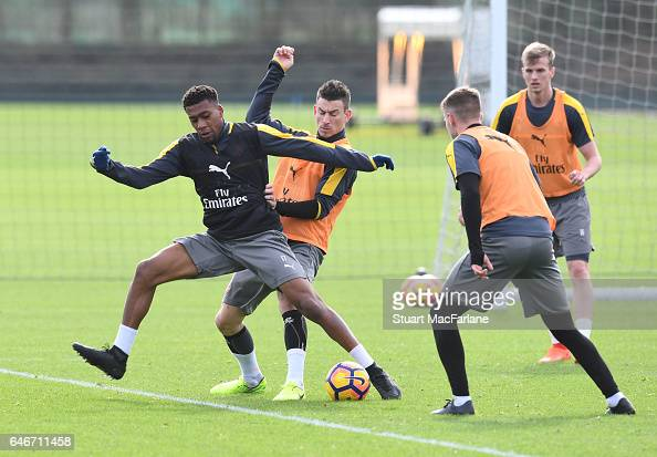 Alex Iwobi Laurent Koscielny and Aaron Ramsey of Arsenal during a training session at London Colney on March 1 2017 in St Albans England