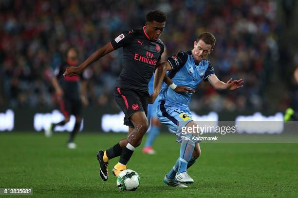 Alex Iwobi of Arsenal and Brandon O'Neill of Sydney FC compete for the ball during the match between Sydney FC and Arsenal FC at ANZ Stadium on July...
