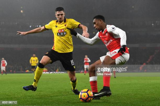 Alex Iwobi of Arsenal and Craig Cathcart of Watford compete for the ball during the Premier League match between Arsenal and Watford at Emirates...