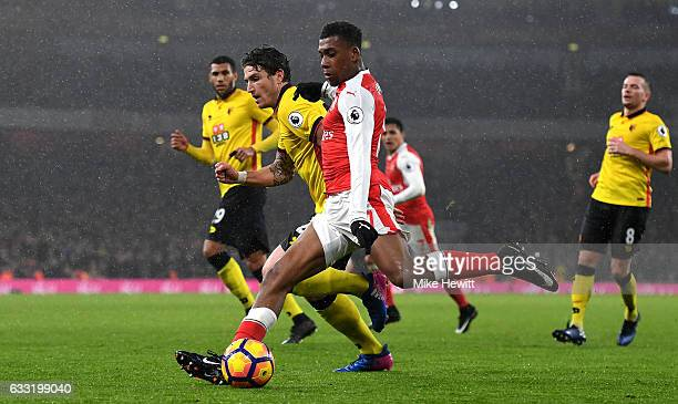 Alex Iwobi of Arsenal and Daryl Janmaat of Watford compete for the ball during the Premier League match between Arsenal and Watford at Emirates...
