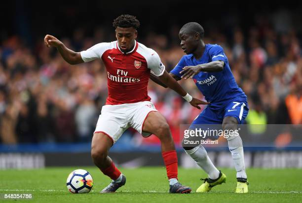 Alex Iwobi of Arsenal and N'Golo Kante of Chelsea battle for possession during the Premier League match between Chelsea and Arsenal at Stamford...