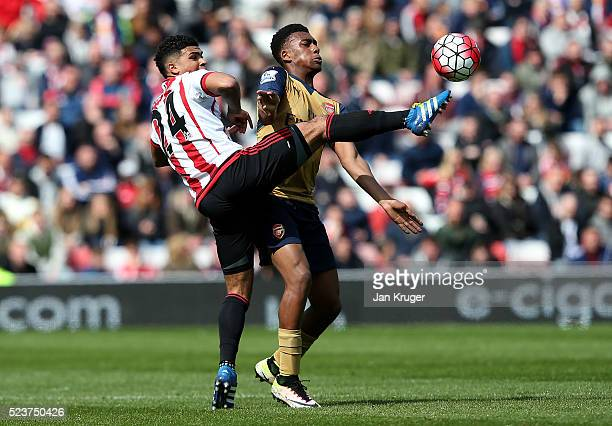 Alex Iwobi of Arsenal battle for the ball DeAndre Yedlin of Sunderland during the Barclays Premier League match between Sunderland and Arsenal at the...