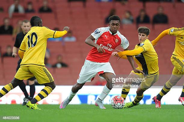 Alex Iwobi of Arsenal breaks past Larnell Cole and Emerson Hyndman of Fulham during the Barclays U21 match between Arsenal and Fulham at Emirates...