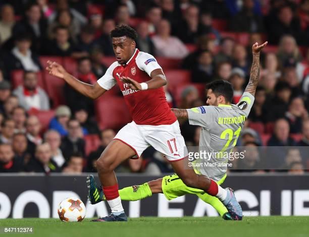 Alex Iwobi of Arsenal breaks past Leonardo Bittencourt of Koln during the UEFA Europa League group H match between Arsenal FC and 1 FC Koeln at...