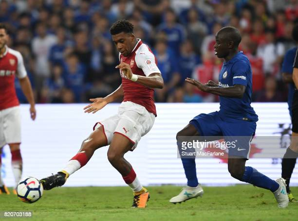 Alex Iwobi of Arsenal breaks past N'Golo Kante of Chelsea during the pre season friendly between Arsenal and Chelsea at the Birds Nest on July 22...