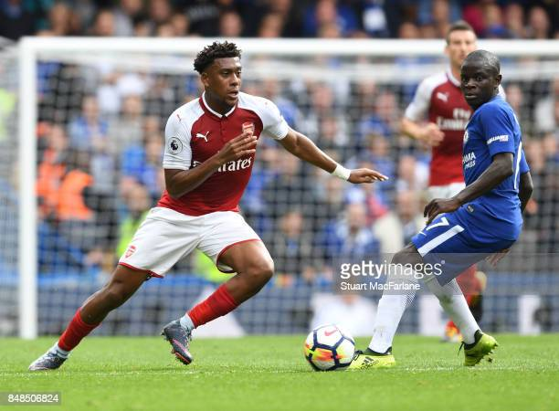 Alex Iwobi of Arsenal breaks past N'Golo Kante of Chelsea during the Premier League match between Chelsea and Arsenal at Stamford Bridge on September...