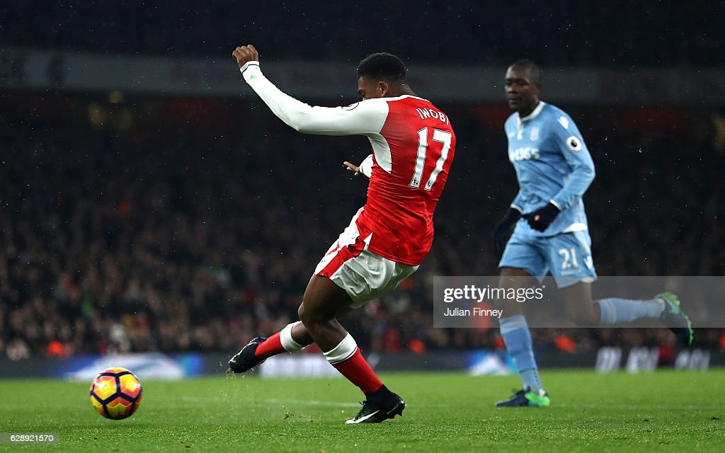 Alex Iwobi of Arsenal celebrates scoring his sides third goal during the Premier League match between Arsenal and Stoke City at the Emirates Stadium on December 10, 2016 in London, England.