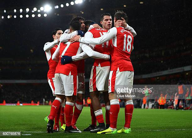 Alex Iwobi of Arsenal celebrates with teammates after scoring his team's second goal during the Premier League match between Arsenal and Crystal...