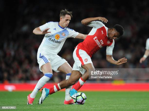 Alex Iwobi of Arsenal challenged by Adnan Januzaj of Sunderland during the Premier League match between Arsenal and Sunderland at Emirates Stadium on...