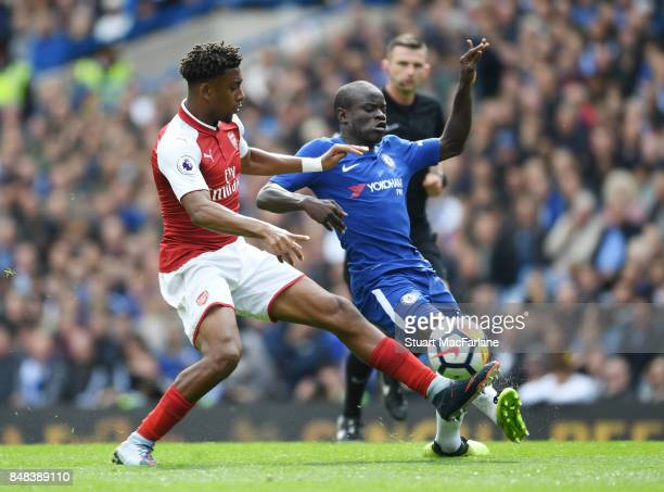 Alex Iwobi of Arsenal challenged by N'Golo Kante of Chelsea during the Premier League match between Chelsea and Arsenal at Stamford Bridge on...