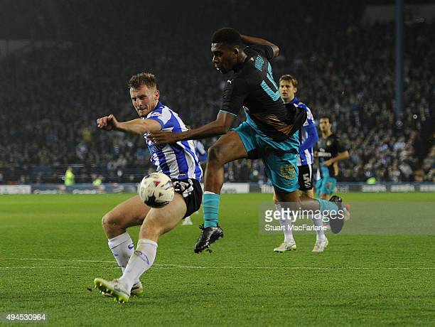 Alex Iwobi of Arsenal challenged by Tom Lees of Sheffield Wednesday during the Capital One Cup Fourth Round match between Sheffield Wednesday and...