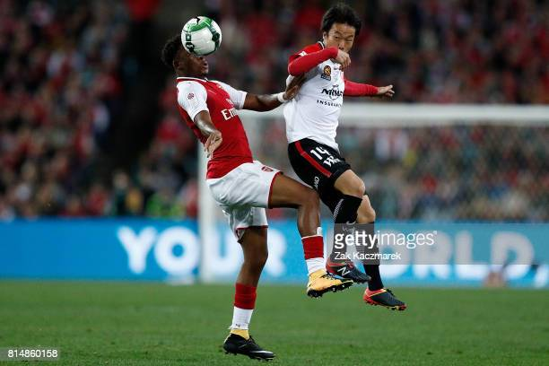 Alex Iwobi of Arsenal chellenges Jumpei Kusukami of the Wanderers during the match between the Western Sydney Wanderers and Arsenal FC at ANZ Stadium...