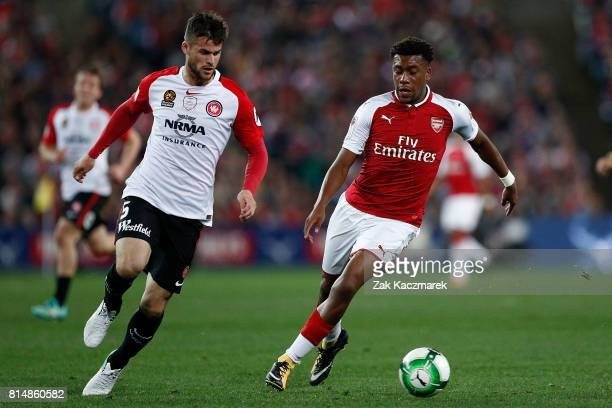 Alex Iwobi of Arsenal controls the ball and evades Brendan Hamill of the Wanderers during the match between the Western Sydney Wanderers and Arsenal...