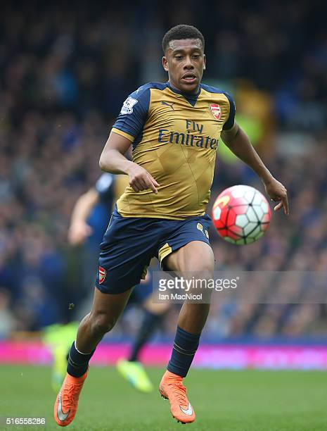 Alex Iwobi of Arsenal controls the ball during the Barclays Premier League match between Everton and Arsenal at Goodison Park on March 19 2016 in...